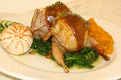 Roasted Quail Studded with our cornbread stuffing/