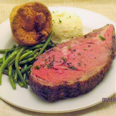 Prime Rib, slow cooked and served with traditional yorkshire pudding- The Boar's Head Restaurant & Tavern Panama City Beach, Fl.